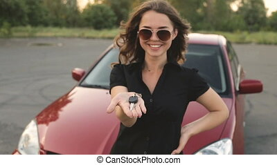 Happy girl with key in hand from new car - Lovely girl...