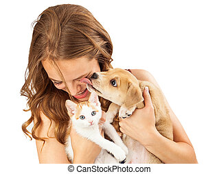 Happy Girl With Kitten and Affectionate Puppy - A pretty...
