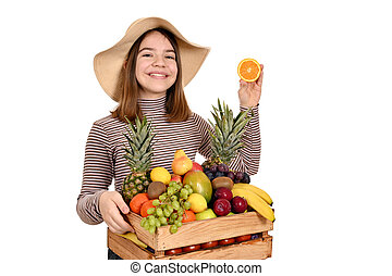 happy girl with orange and other fruits