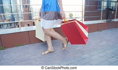 Happy girl with packages after shopping - Happy young woman...
