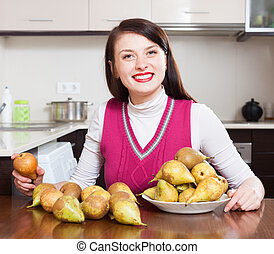 Happy girl with pears in home