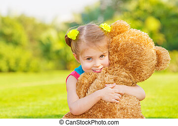 Happy girl with soft toy