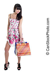 Happy girl with striped bags in transparent dress