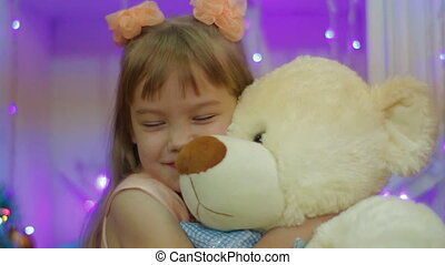 Happy girl with Teddy bear. Present for New Year for child