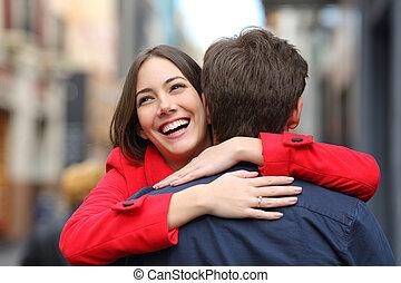 Happy girlfriend hugging her boyfriend after proposal