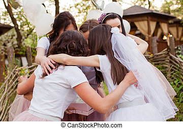 Happy girlfriends hugging and having fun celebrating bachelorette party.