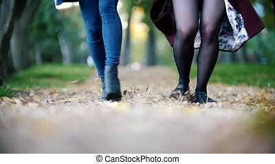 Happy girls having fun outdoors. girls running at the park. Two girls holding hands