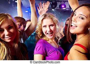 Happy girls - Image of happy young girls having fun at disco...