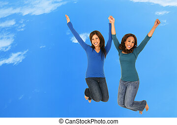 Happy Girls Jumping Over The Cloud