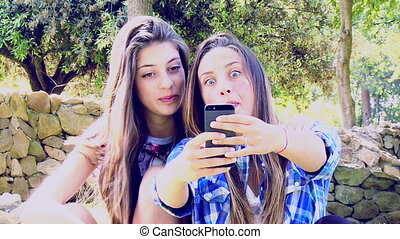 Happy girls taking selfie