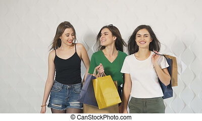 Happy Girls Walk after Shopping