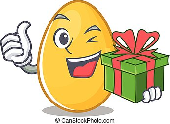 Happy golden egg character having a gift box
