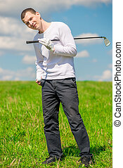 happy golfer portrait in full length on the field