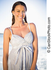 Happy gorgeous woman in summer dress posing