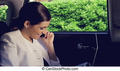 Happy gorgeous woman talking on the phone in cab closeup -...