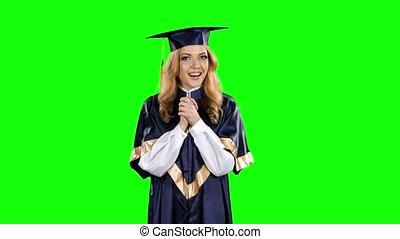 Happy graduate girl. Green screen