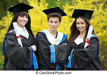 happy graduate students outdoors