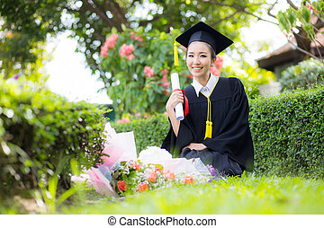 Happy graduated student girl - congratulations of education success.