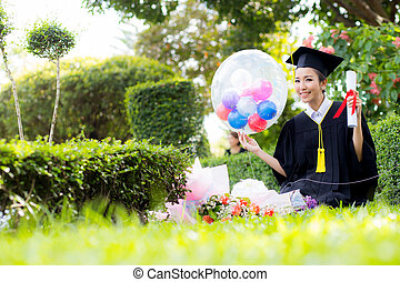 Happy graduated student girl - congratulations of education success.