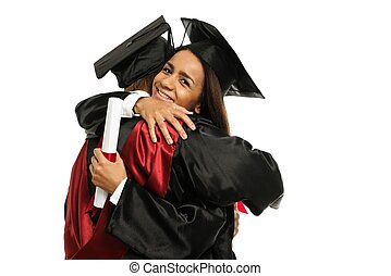 Happy graduated young multi ethnic students couple hugging