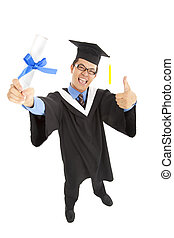 happy graduating student holding diploma  with thumbs up