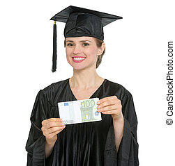 Happy graduation student woman showing pack of euros isolated