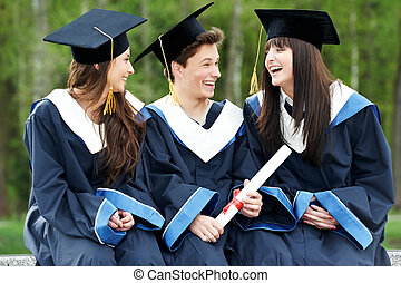 happy graduation students - group of three graduation...