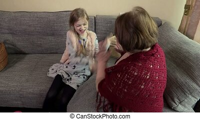 Happy Granddaughter with Grandmother on couch
