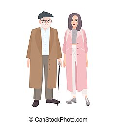 Happy grandfather and granddaughter dressed in stylish...