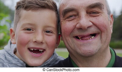 Happy grandfather and grandson together are laughing. ...