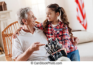 Happy grandfather talking with his granddaughter