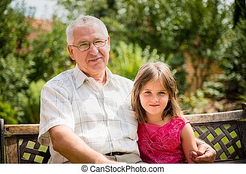Happy grandfather with grandchild