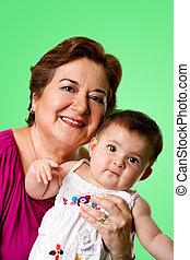 Happy grandma and cute baby