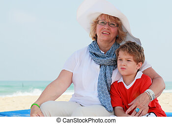 happy grandma and grandson on vacation at sea