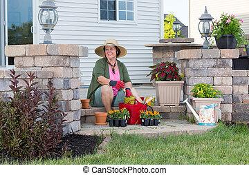Happy Grandma planting in her garden