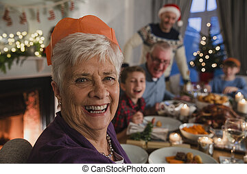 Happy Grandmother At Christmas Dinner