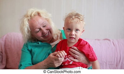 Happy grandmother with her little grandson.