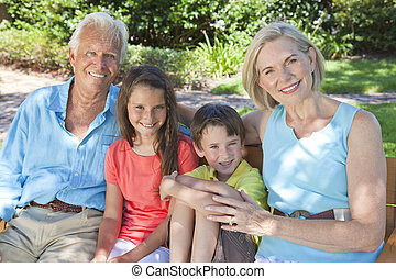 Happy Grandparents and Children Family Outside