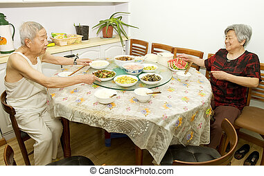 happy Grandparents at the dinner table