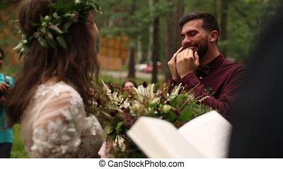 Happy groom admires seeing bride