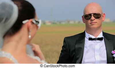 Happy Groom And Bride In Sunglasses Posing At the Nature