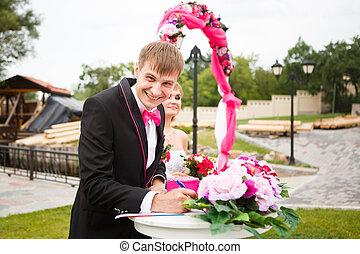 Happy groom in wedding ceremony