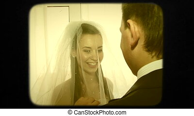 Happy Groom Raising Up  Veil Of His Young Beautiful Smiling Bride