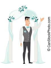 Happy groom standing under the wedding arch.