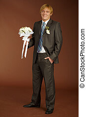 Happy groom with bouquet - Happy groom with a bouquet on...