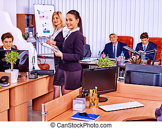 Happy group business people are printing out in office. -...