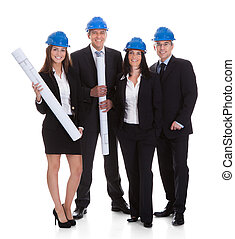 Happy Group Of Architects With Blueprints