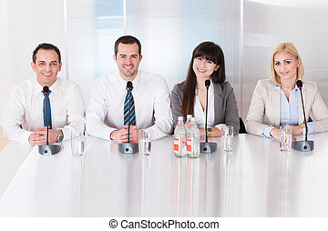 Group Of Business People Sitting In Conference