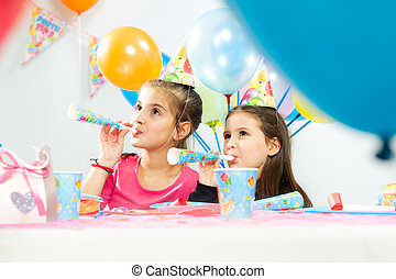 Happy group of children having fun at birthday party