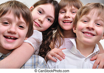 happy group of children hugging together